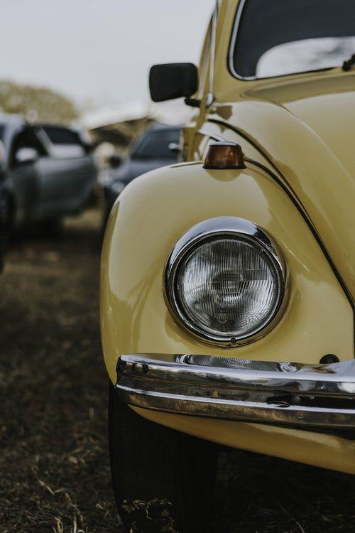 The Passenger Side Headlight Of A Yellow Car Yellow Aesthetic Yellow Car Aesthetic Vintage