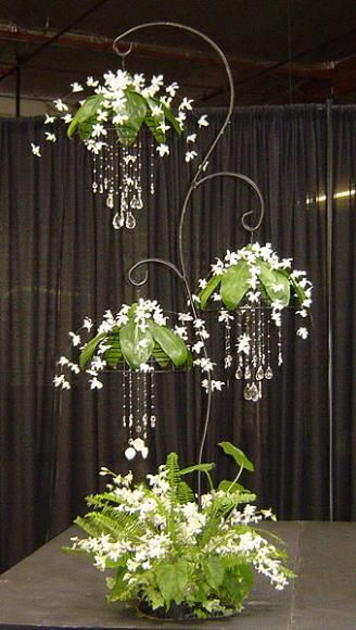 Diamonds in the Rough suspended arrangement by Manuel Cuate.  Hanging lamps with hand strung crystals, gardenias and showering dendrobium orchid florets. Designed by Manuel Cueta.