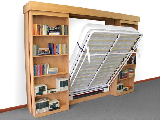 I like this idea the murphy bed hides behind sliding for Bookshelf behind bed