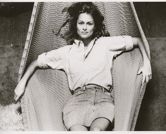 Lauren Hutton in a button-down and jean skirt.