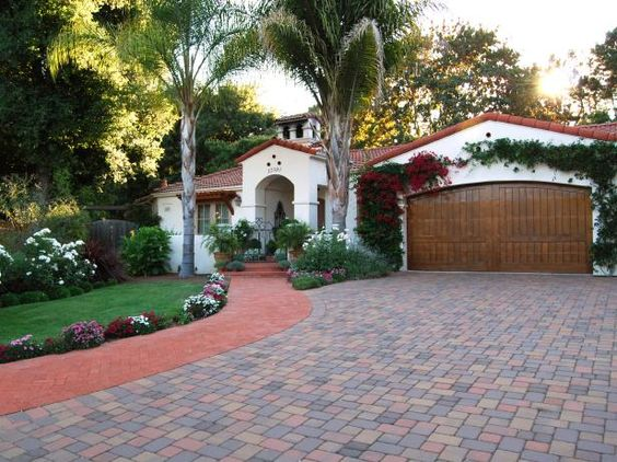 See a gorgeous Spanish Colonial Revival house framed by palm trees and bougainvillea on HGTV.