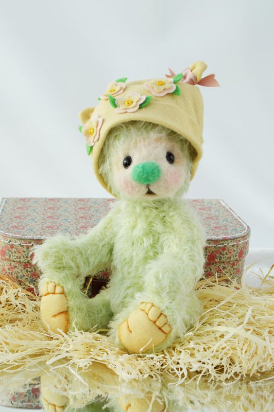 This darling little bear has been lovingly made in apple green mohair. It is made from my own pattern and has been completely sewn by hand,