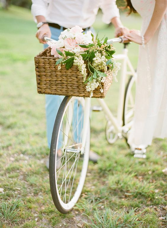 Adorable floral-covered bike, complete with a matching bike basket! The perfect prop!   Style Me Pretty