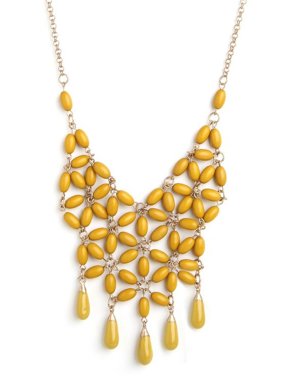 Make a buoyant and bold statement with this stunning necklace, which showcases a dramatic mesh motif. Our favorite part though? The way those beads form a charming floral pattern.
