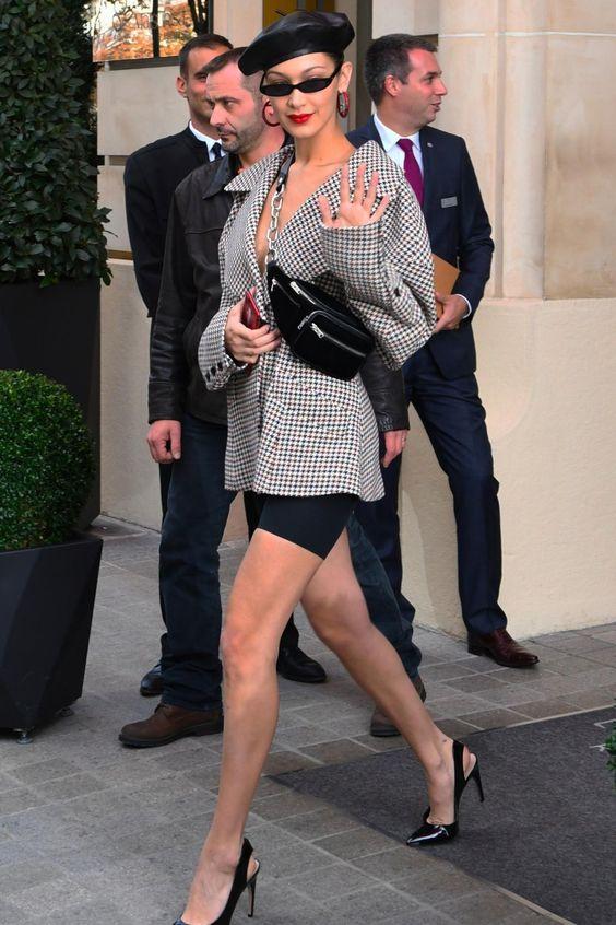 Bella Hadid wearing Roberi & Fraud Frances Sunglasses, Alexander Wang Attica Fanny Pack, Fendi F Is Fendi Earrings and Dior Slingback Pumps