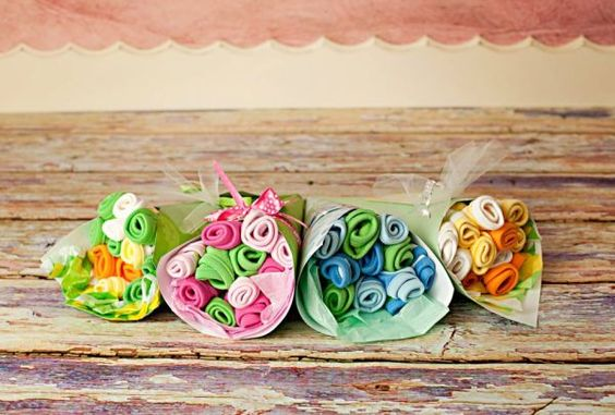 6 baby washcloths made into a dozen flowers & wrapped in paper and ribbon- cute and easy.