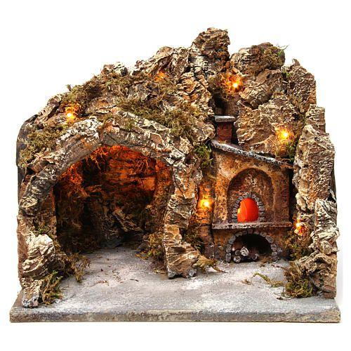 Grotta con forno illuminato e luci esterne legno e sughero