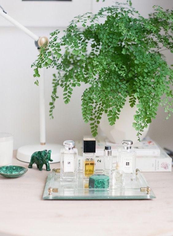 Chic + modern vanity tray: http://www.stylemepretty.com/living/2015/11/12/cocokelleys-bright-seattle-loft-tour/