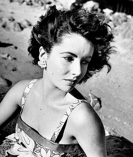 A fifteen-year-old Elizabeth Taylor photographed at the beach by J.R. Eyerman, summer 1947 ...