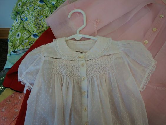Love the details on this Smocked Baby Dress.