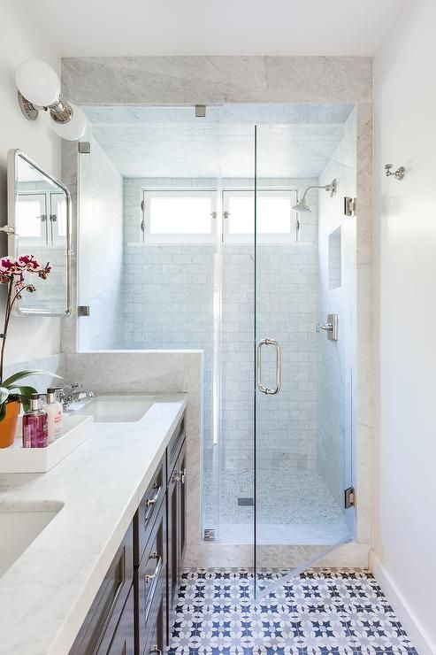 White Blue And Gray Mosaic Floor Tiles Are Fitted In A Long Bathroom And Lead To A Seamless Glass Sh White Bathroom Tiles Grey Bathrooms Bathroom Floor Tiles