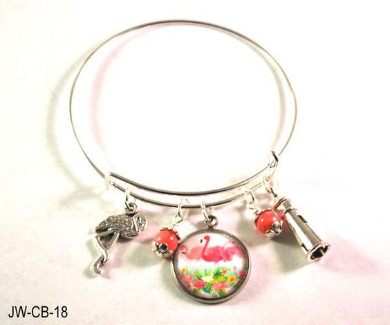 Flamingo Bangle Bracelet  Nothing says Miami like the site of pink flamingos flying from the river. If you love Florida, Miami or just flamingos, then you will love this adjustable bangle bracelet featuring flamingo charms, a lighthouse charm and two pink beads dancing in the wind. If you or a friend loves the tropics,