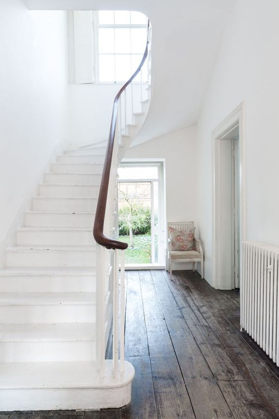 staircase and sash and case window. and wooden floors