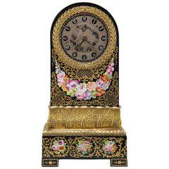 A Charles X period ormolu mounted Jacob Petit porcelain mantel clock