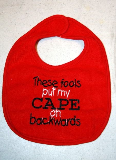 Cape bib in red with black and white writing by KenaKreations, $7.00