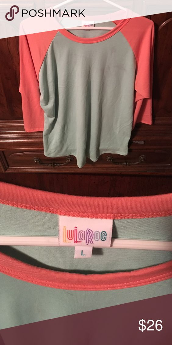Lu La Roe Randy True to size LuLa Roe Randy worn a few times in good condition. Sleeves are a peach color and body of shirt is aqua. LuLaRoe Tops Tees - Short Sleeve