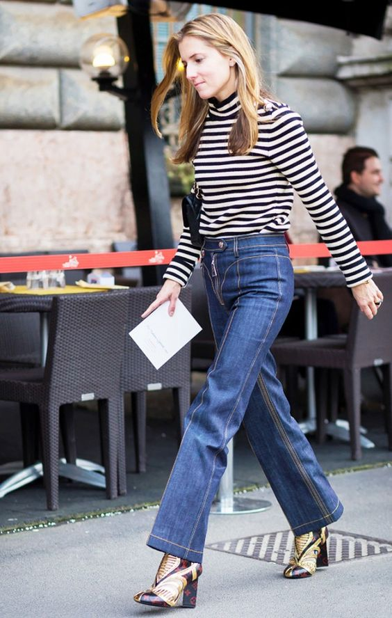 Marine Larroude of Teen Vogue wears a striped turtleneck, Louis Vuitton flared jeans and boots