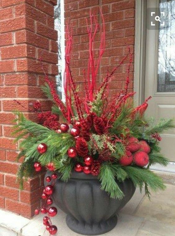 leafy stems or branches and Christmas balls for winter garden container #christmas  #containers #planters #gardenplanters #christmasBall