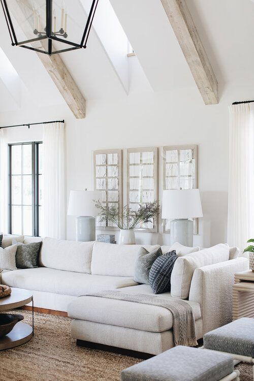 Beautiful light filled living room with wood beams and neutral tones - Kate Marker Interiors