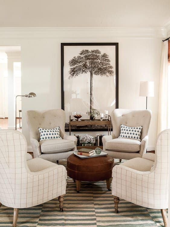 living room sitting chairs. 4 chairs in circle around round ottoman  striped area rug by Lauren Leiss Fireplace room Pinterest Round Ottomans and Room