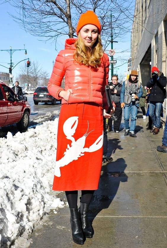 Pin for Later: Snow Problem! 33 Blizzard-Proof Street Style Looks  This orange-on-orange look is proof that even the practical puffer can be chic. Wear on the next snow day, and rejoice.