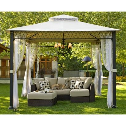 Backyard oasis...gazebo, lighting and furniture...<3