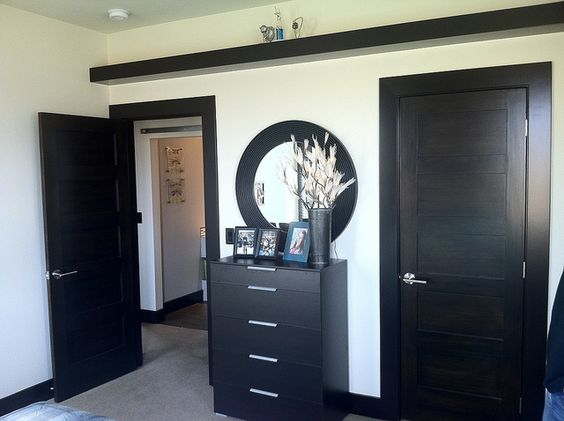 dark trim dark doors light brown walls damn this will look like the closet area in our room. Black Bedroom Furniture Sets. Home Design Ideas