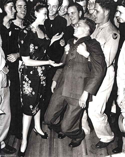 "A solider goes ""weak at the knees"" after Linda Darnell asks him to dance at the Hollywood Canteen, 1940s"