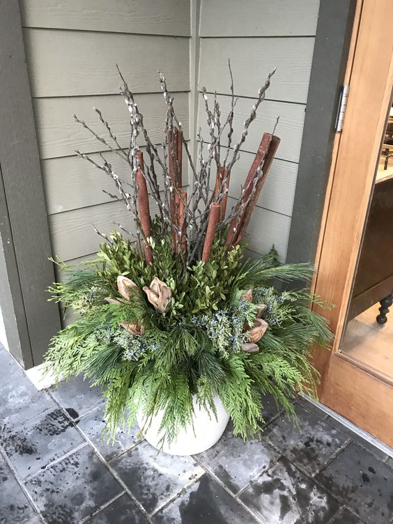 Decorative logs for a winter garden container #christmas  #containers #planters #gardenplanters #log