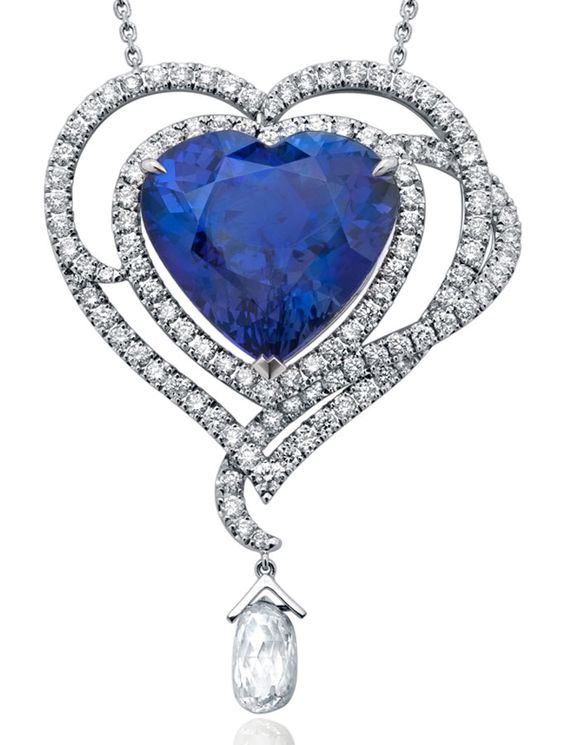 Boodles. 14 carat heart shaped tanzanite pendant encrusted with diamonds and with a briolette diamond drop.: