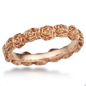 Ring o' Roses Wedding Band - This sculptural wedding ring is made of roses.  Each flower is handcrafted and planted on the inner band with love.