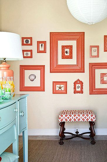 11 Tips For Creating a Gallery Wall in Your Home: For major visual impact, spray paint all of the frames an out of the ordinary color that complements your rooms color palette. Designer Tobi Fairley also chose to frame seashells instead of traditional artwork. Source