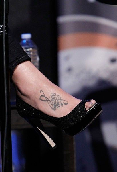 I love Hillary Scott's foot tattoo. I think it would look great with some lyrics around the clef.