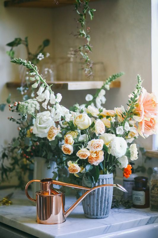 Kitchen decorating ideas with rustic decor and modern farmhouse style. Beautiful floral arrangement by Beth Kirby of Local Milk. #kitchendecor #floral #centerpiece #bethkirby #modernfarmhouse #farmhousekitchen