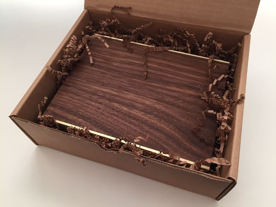Jewlery for the Home - Asher Israelow Bblack walnut and brass trays. Perfect for mother's or father's days!