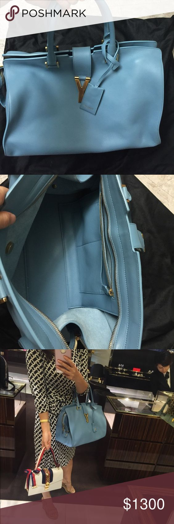 Anth ysl cabas large size gorgeous color Excellent condition . Come with dust bag and cards. Yves Saint Laurent Bags Clutches & Wristlets