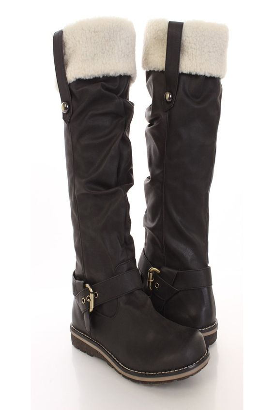 Very stylish boots featuring faux leather upper with faux shearling trim, buckle straps, stitched detailing, slouchy front design, round closed toe, and side zipper closure. Approximately 1 inch low heels.