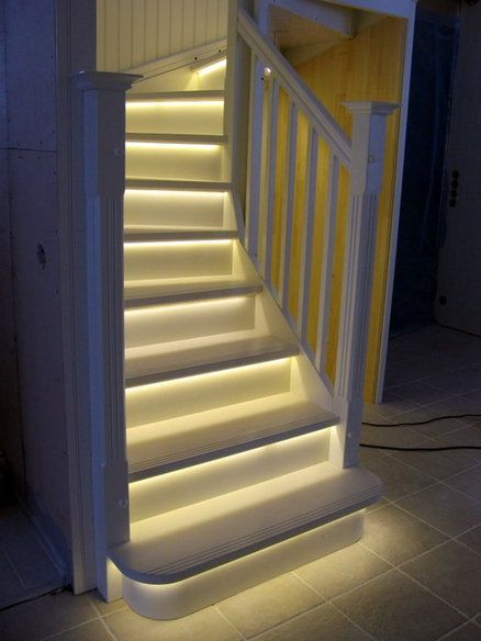 "LED Light strips on stairway. Great idea for basement stairs. ESPECIALLY if there is a ""movie theatre"" in your basement:"