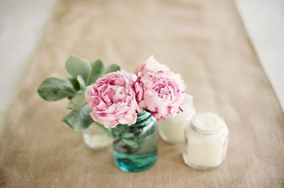 love this sweet and simple pink peony centerpiece // photo by Jonathan Wherrett