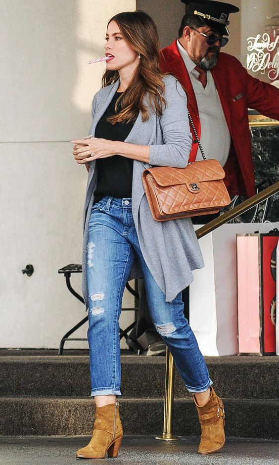 Sofia Vergara in a gray cardigan, black top, ripped jeans and booties - click through to see more celebrity winter outfit ideas