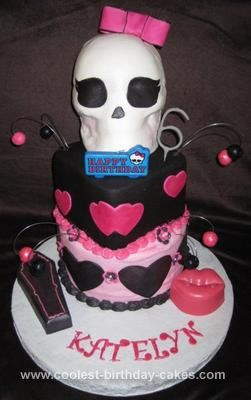 Homemade Monster High Draculaura Birthday Cake: This Monster High Draculaura Birthday Cake is based off of the Monster High character Draculaura. I used an 8 inch 3 layer cake on the bottom covered in