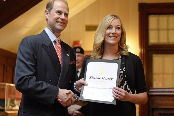 Prince Edward presents Shanae Harvey with the The Duke of Edinburgh's International Award at Government House in Regina on Thursday.