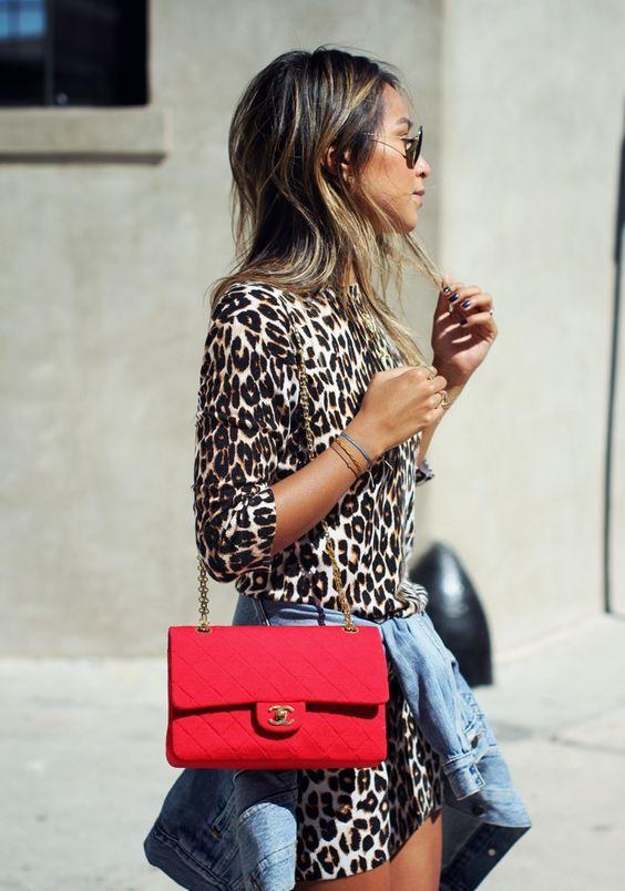 Animal print dress, denim jacket and red chanel shoulder bag.