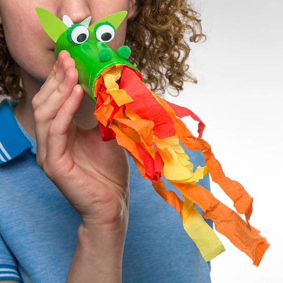 Up-cycling household items makes crafting this fire breathing dragon easy! Simply paint a used kitchen roll tube! #StGeorgesDay #DIY #DragonDIY #DragonCrafts #KidsCrafts