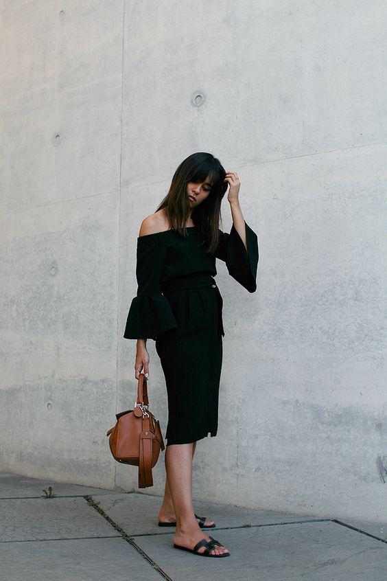 Nisi is wearing: Off-the-shoulder top with bell sleeves, midi skirt with slit, Hermès Oran sandals, Loewe Puzzle Bag - teetharejade.com