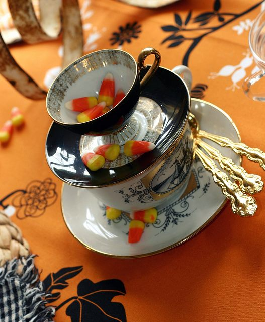 Fall teacup stack & candy corn (Kay Ellen Hammar). #china #dishes #fall #autumn #tea #teacup #tablesetting #decor #table #party #elegant #pretty #chic: