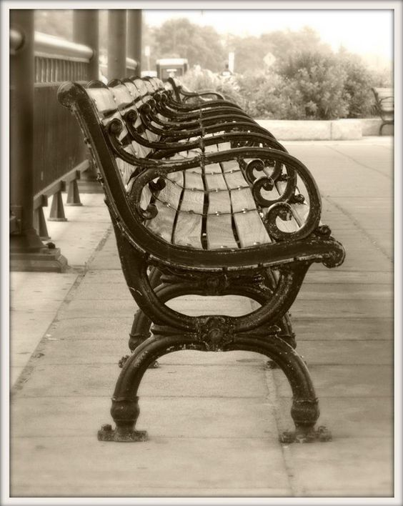 Antique wrought iron bench at historic Revere Beach in Massachusetts. Revere Beach became America's first public beach in 1896. MEMBER - Anita Rosselle