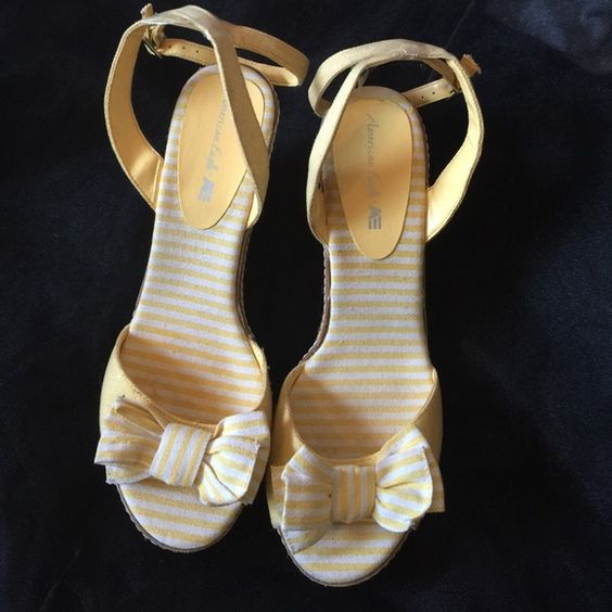 Size 10 Wedges I'm selling a pair of size 10 around the ankle yellow and white wedges. They have been worn but are overall good condition. American Eagle Outfitters Shoes Wedges
