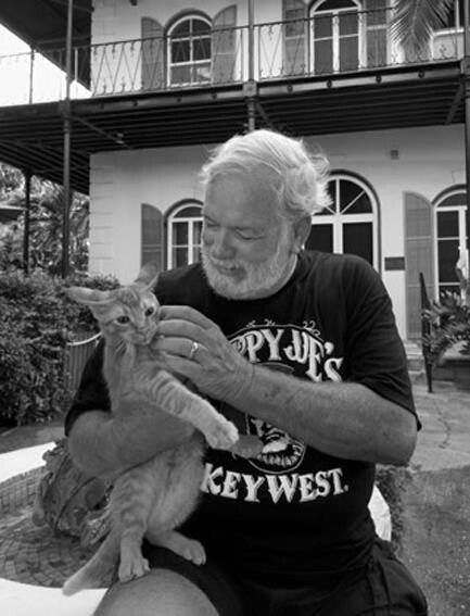 Hemingway, shown with his orange tabby, loved cats. His house in the Florida Keys still has cats roaming around it.