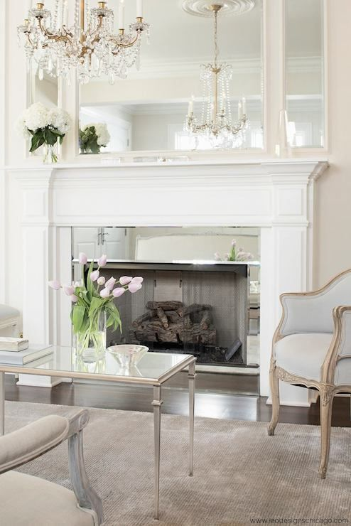 Love the mirror touch around the fireplace - as well as the elegant beautiful room!